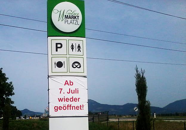 Pylonbeschriftung Walser Markt Platz